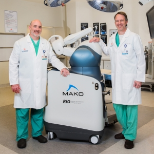 Denny A. Carter, M.D., and Beau Sasser, M.D. with the Mako robotic surgery system